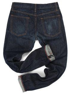 Pantaloni conici cu buzunare oblice